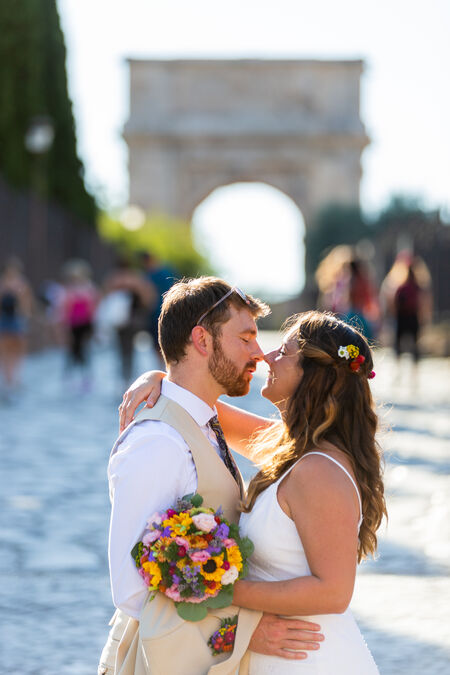 Oriana & Ben, newly-weds, in a romantic embrace on Via Sacra, in Rome